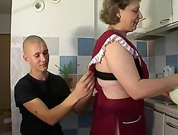 Full-grown Old woman with pleasure to young boy