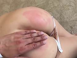 Stunning girl spanked by her Padre